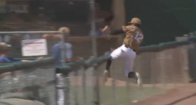 "<a class=""link rapid-noclick-resp"" href=""/ncaab/players/143914/"" data-ylk=""slk:Eric Jenkins"">Eric Jenkins</a> goes up and over the left-field foul line fence. (Via @AlexWalkerTV)"