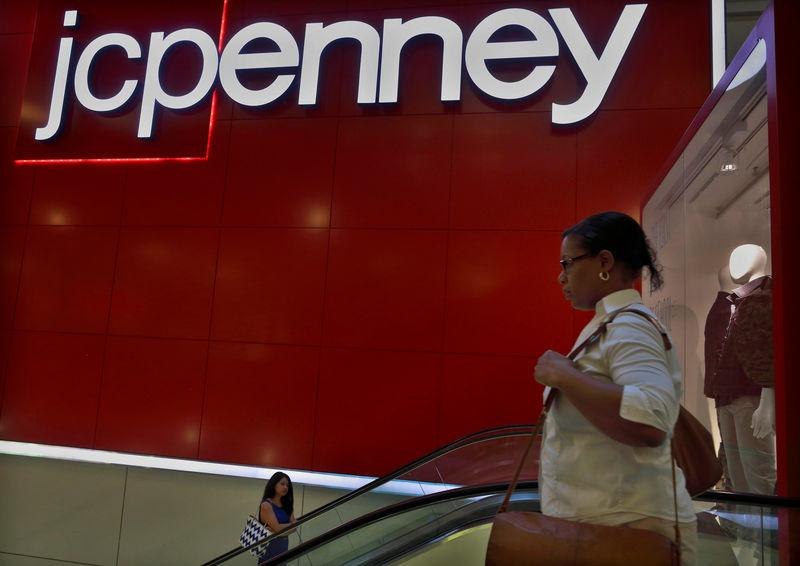 FILE PHOTO - Customers ride the escalator at a J.C. Penney store in New York