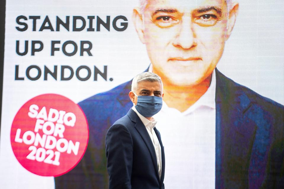 Sadiq Khan unveiling a new campaign advert while out on the campaign trail on Thursday (PA)