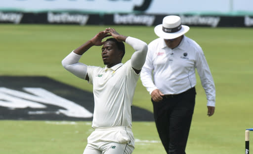 South Africa's Lungi Ngidi reacts after bowling on day one of the first cricket test match between South Africa and Sri Lanka at Super Sport Park Stadium in Pretoria, South Africa, Sat 26 December, 2020. (AP Photo/Catherine Kotze)