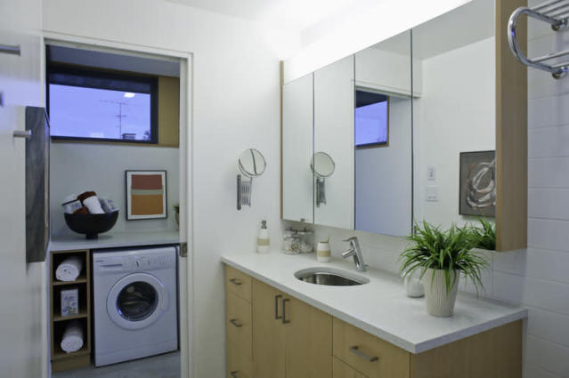 <p>Master bath, with washer and dryer right outside sliding bathroom door. (LaneFab) </p>