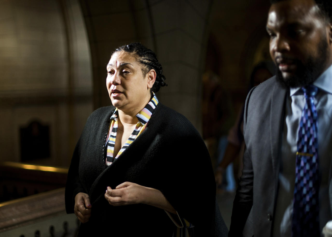 Michelle Kenney, right, mother of Antwon Rose II, and family attorney, S. Lee Merritt, left, walk toward the courtroom prior to the start of the second day of the homicide trial of former East Pittsburgh police officer Michael Rosfeld, Wednesday, March 20, 2019, at the Allegheny County Courthouse in Pittsburgh. Rosfeld is charged with homicide in the fatal shooting of Antwon Rose II as he fled during a traffic stop on June 19, 2018. (Nate Smallwood//Pittsburgh Tribune-Review via AP, Pool)