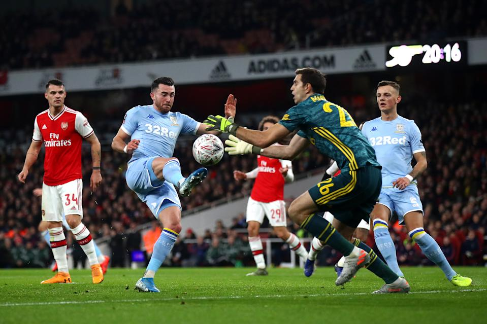 LONDON, ENGLAND - JANUARY 06:  Jack Harrison of Leeds United is closed down by Emiliano Martinez of Arsenal during the FA Cup Third Round match between Arsenal FC and Leeds United at the Emirates Stadium on January 06, 2020 in London, England. (Photo by Julian Finney/Getty Images)