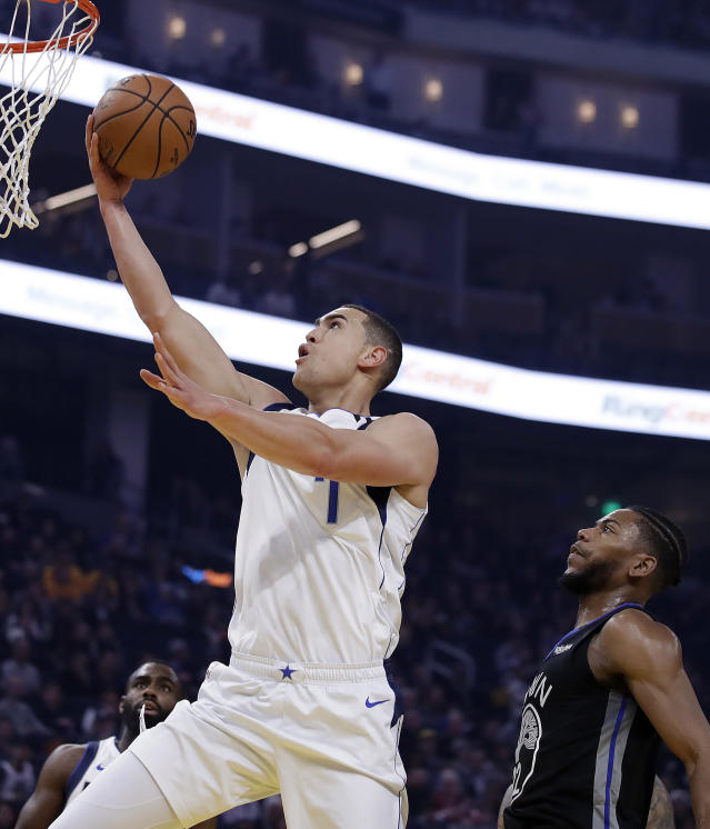 Dallas Mavericks' Dwight Powell, left, lays up a shot past Golden State Warriors' Glenn Robinson III (22) during the first half of an NBA basketball game Tuesday, Jan. 14, 2020, in San Francisco. (AP Photo/Ben Margot)
