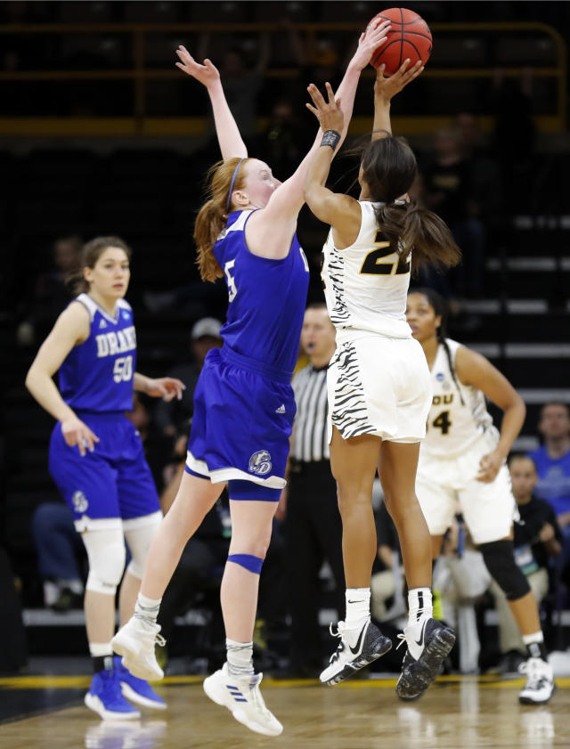 Drake guard Becca Hittner (5) fouls Missouri guard Jordan Roundtree (22) at the end of overtime in a first round women's college basketball game in the NCAA Tournament, Friday, March 22, 2019, in Iowa City, Iowa. (AP Photo/Charlie Neibergall)