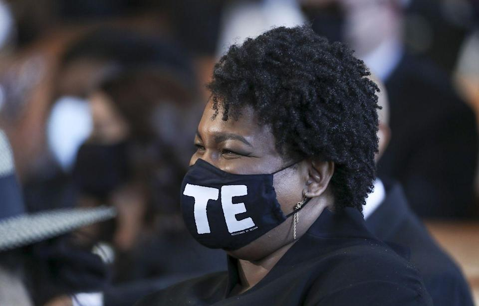 "<p>Former candidate for governor of Georgia, Stacey Abrams, attended the funeral, wearing a black mask saying ""VOTE.""</p>"