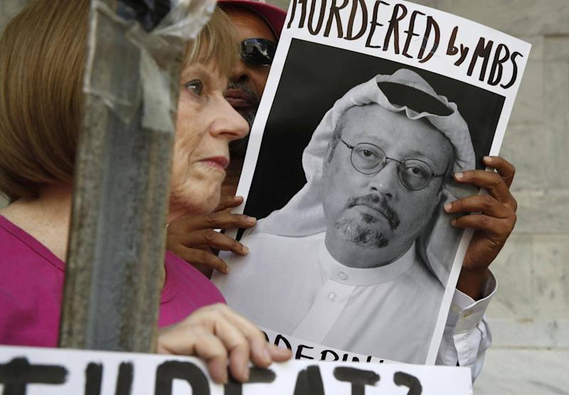 People hold signs during a protest at the Embassy of Saudi Arabia about the disappearance of Saudi journalist Jamal Khashoggi, in Washington on 10 October (AP)