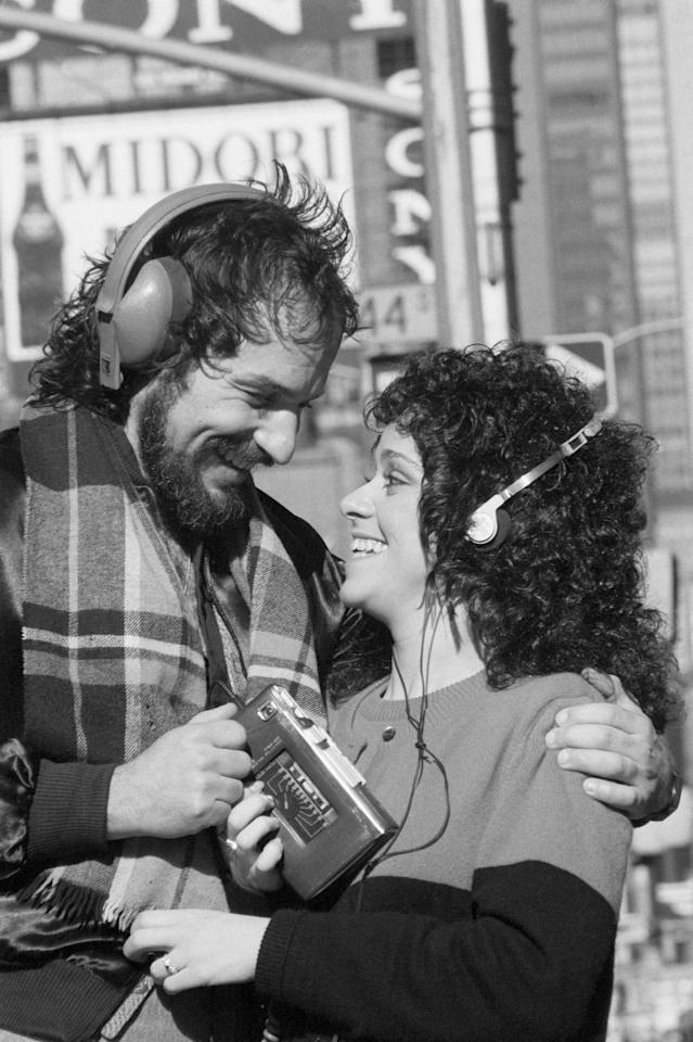 <p>Two Broadway actors, Patrick Jude and Lisa Mordente, share a Walkman in Times Square, 1981.</p>