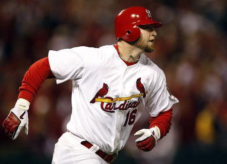 FILE PHOTO: St. Louis Cardinals' Chris Duncan runs the bases after hitting a solo home run against the New York Mets in the sixth inning of Game 5 of their NLCS playoff baseball series in St. Louis October 17, 2006. REUTERS/Hans Deryk (UNITED STATES)