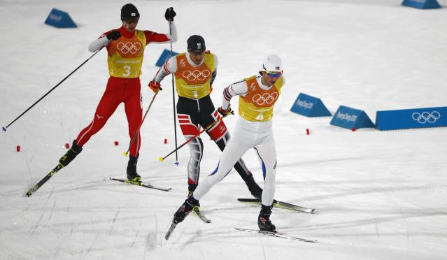 Nordic Combined Events - Pyeongchang 2018 Winter Olympics - Men's Team 4 x 5 km Final - Alpensia Cross-Country Skiing Centre - Pyeongchang, South Korea - February 22, 2018 - Jarl Magnus Riiber of Norway competes with Bernhard Gruber of Austria and Go Yamamoto of Japan. REUTERS/Dominic Ebenbichler