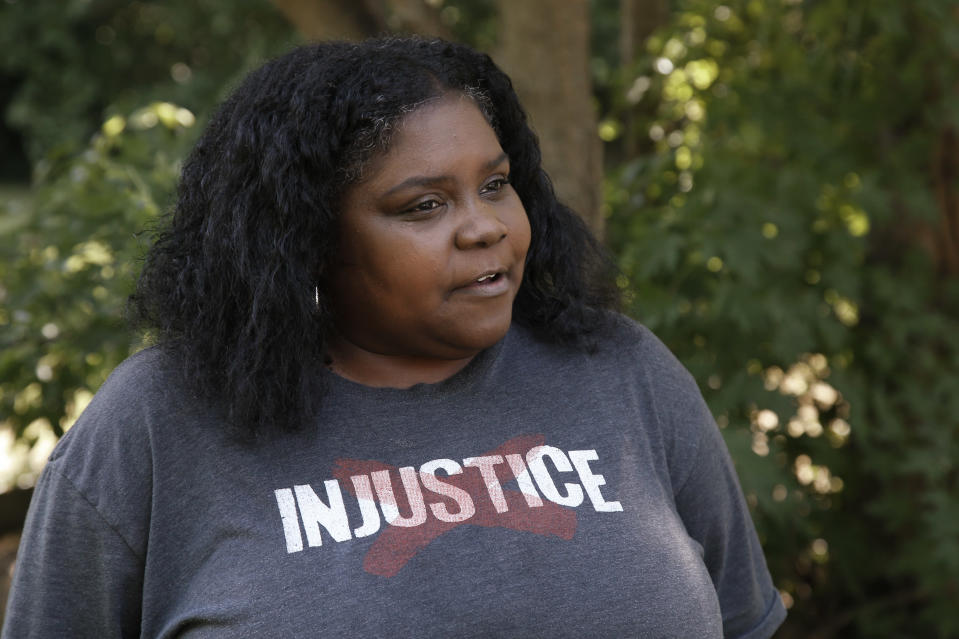 """In this Monday, June 15, 2020 photo, Kristi Williams speaks during an interview at her home in Tulsa, Okla. Unlike Black Americans across the country after slavery, Williams' ancestors and thousands of other Black members of slave-owning Indian nations freed after the war """"had land,"""" says Williams, a Tulsa community activist. """"They had opportunity to build a house on that land, farm that land, and they were wealthy with their crops."""" (AP Photo/Sue Ogrocki)"""
