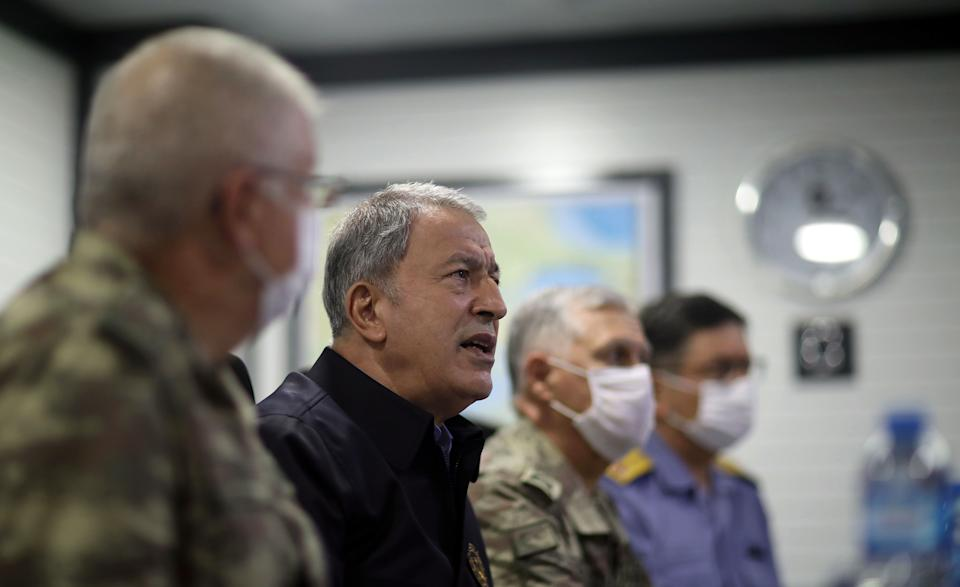 KOCAELI, TURKEY - AUGUST 14: Turkish National Defense Minister Hulusi Akar and Turkish Armed Forces' command echelon, take briefing and inspect at the Navy Command in Golcuk where the military ships accompanying the Oruc Reis seismic vessel are commanded in Kocaeli, Turkey on August 14, 2020. (Photo by Arif Akdogan/Anadolu Agency via Getty Images) (Photo: Anadolu Agency via Getty Images)