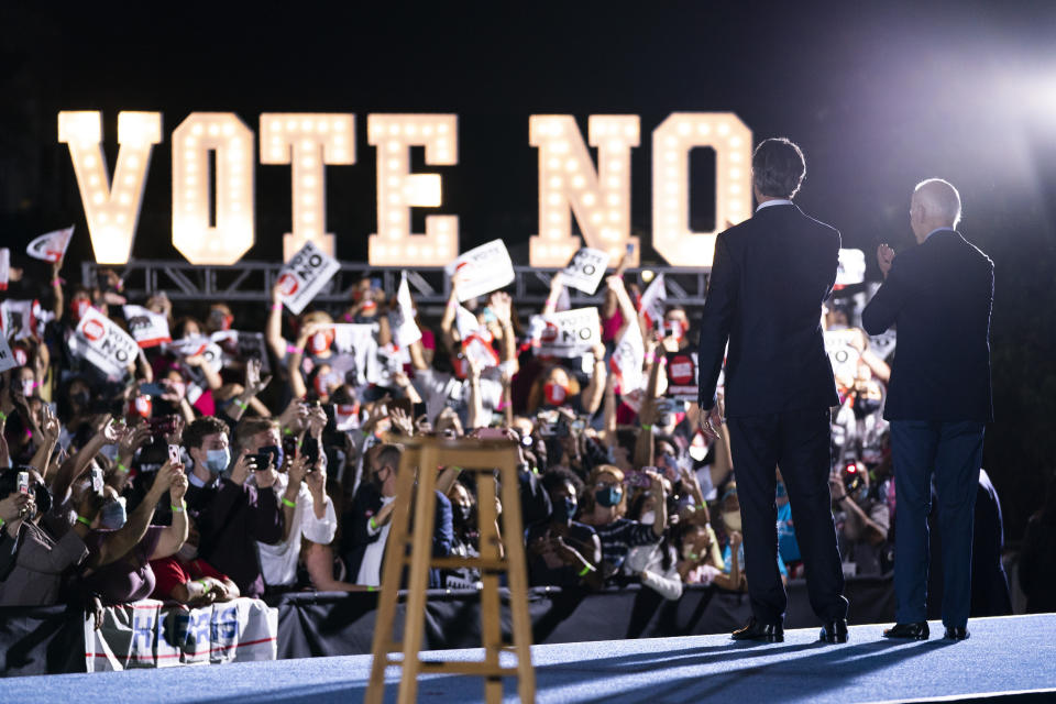 President Joe Biden stands with Gov. Gavin Newsom, D-Calif., during a campaign rally at at Long Beach City College, Monday, Sept. 13, 2021, in Long Beach, Calif. Newsom faces a recall election on Tuesday. (AP Photo/Evan Vucci)