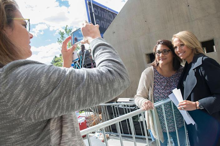 <p>Yahoo Global News Anchor Katie Couric gets her picture with a fan before interviewing Democratic vice presidential nominee and U.S. Sen. Tim Kaine on Thur., Sept. 22, 2016, after he attended a rally at the University of Nevada, Reno. (Renée C. Byer for Yahoo News) </p>