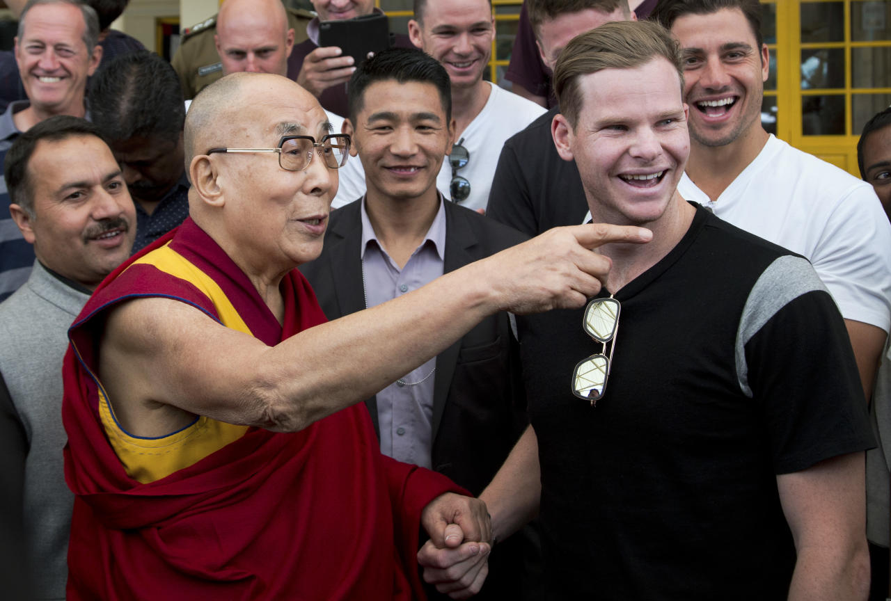 Tibetan spiritual leader the Dalai Lama talks with Australian cricket team captain Steven Smith during an interaction with the team at the Tsuglakhang temple in Dharmsala, India, Friday, March 24, 2017. (AP Photo/Ashwini Bhatia)
