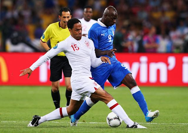 KIEV, UKRAINE - JUNE 24: Joleon Lescott of England challenges Mario Balotelli of Italy during the UEFA EURO 2012 quarter final match between England and Italy at The Olympic Stadium on June 24, 2012 in Kiev, Ukraine. (Photo by Alex Livesey/Getty Images)
