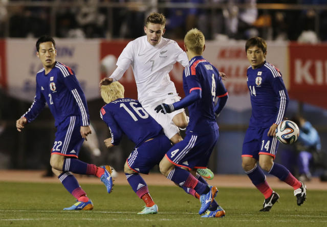 FILE- In this March 5, 2014, file photo, New Zealand's Tyler Boyd (7) and Japan's Hotaru Yamaguchi (16) compete for the ball during a Kirin Challenge Cup international friendly soccer match at the National Stadium in Tokyo. Boyd, a New Zealand-born forward and winger, has been approved by FIFA to switch affiliation to the United States. The 24-year-old Boyd has five goals and four assists in 13 games during the second half of this season for Ankaragucu in Turkey's top division. (AP Photo/Shuji Kajiyama, File)
