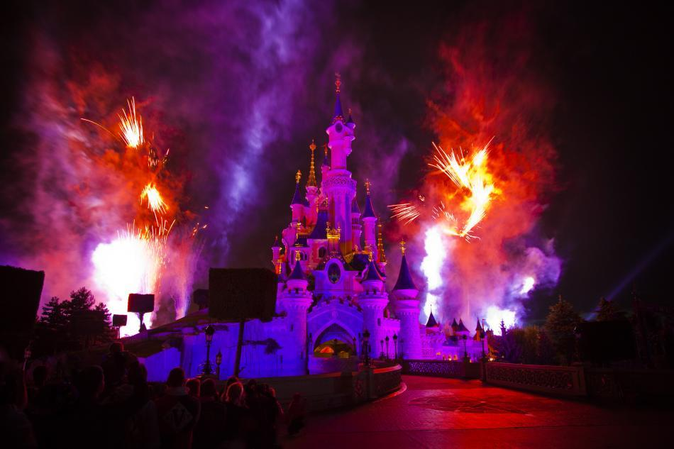 <b>Sleeping Beauty Castle (Fantasyland) at night<br></b>Fireworks bursting behind Sleeping Beauty Castle