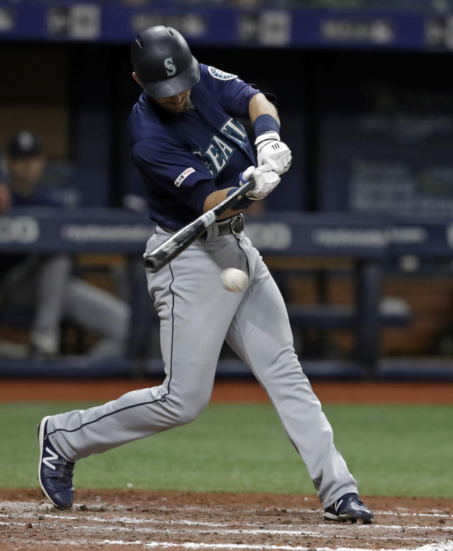 Seattle Mariners' Austin Nola lines an RBI-single off Tampa Bay Rays relief pitcher Chaz Roe during the fourth inning of a baseball game Monday, Aug. 19, 2019, in St. Petersburg, Fla. Seattle's Tim Lopes scored. (AP Photo/Chris O'Meara)