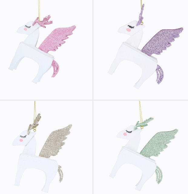 These Christmas Simply Magic White Unicorn Decorations come in four colours and cost $5 from Big W. Photo: Big W.