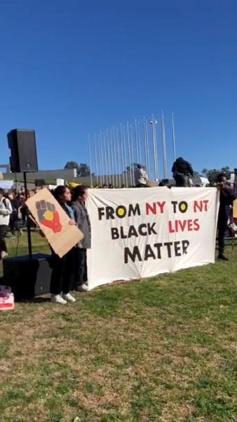 Demonstrators hold a placard during a Black Lives Matter protest in Canberra