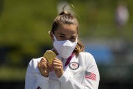Nevin Harrison, of the United States, holds up her gold medal after winning the women's canoe single 200m final at the 2020 Summer Olympics, Thursday, Aug. 5, 2021, in Tokyo, Japan. (AP Photo/Lee Jin-man)