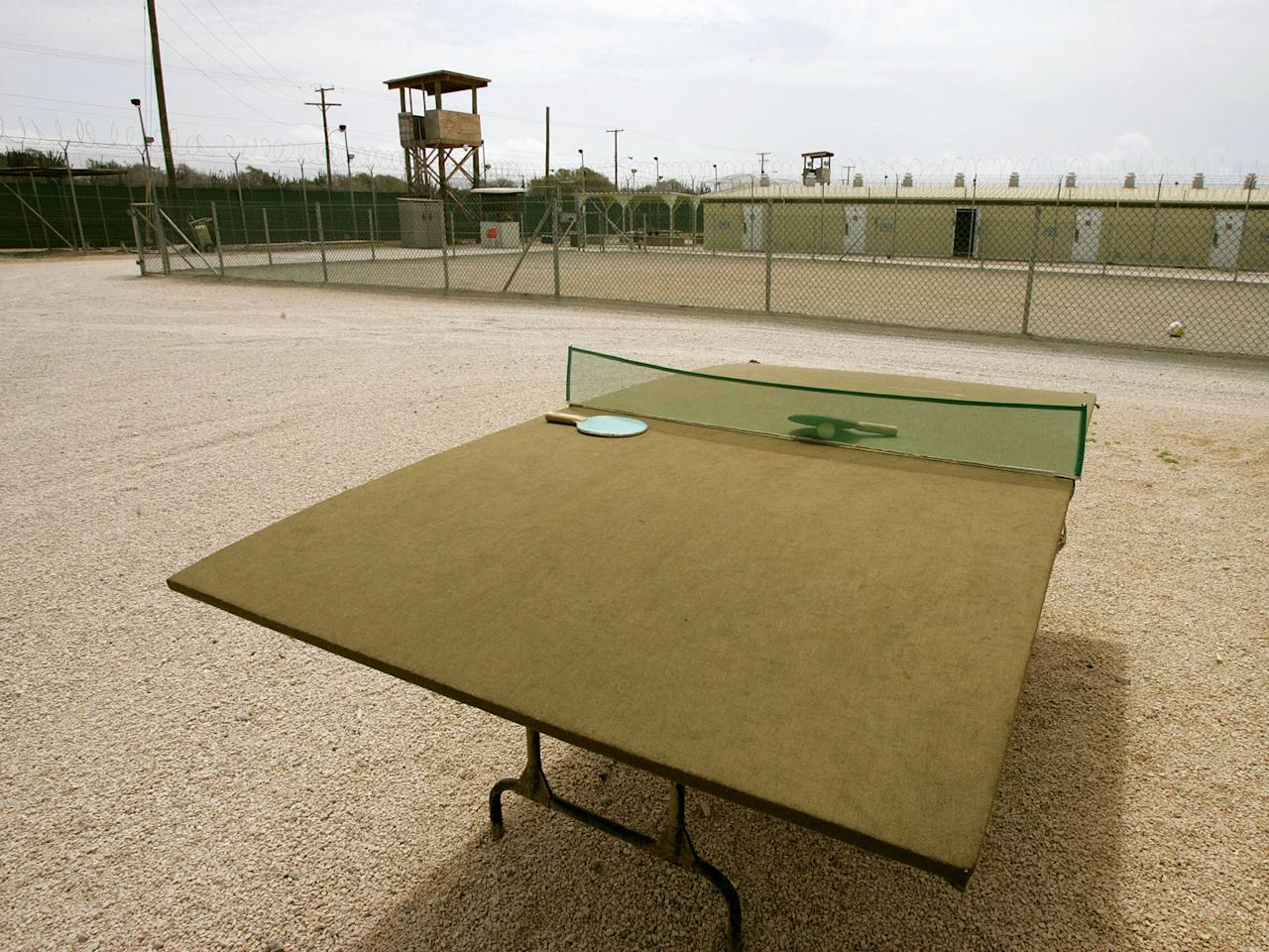GUANTANAMO BAY, CUBA - AUGUST 23:  A ping pong table for detainees sits in the middlle of a court yard at Camp Delta at Guantanamo Naval Base August 23, 2004 in Guantanamo, Cuba. On August 24, preliminary hearings will begin for four suspected Al Qaeda associates charged by the U.S. with war crimes as they appear before a commission of five military officers.  (Photo by Mark Wilson/Getty Images)
