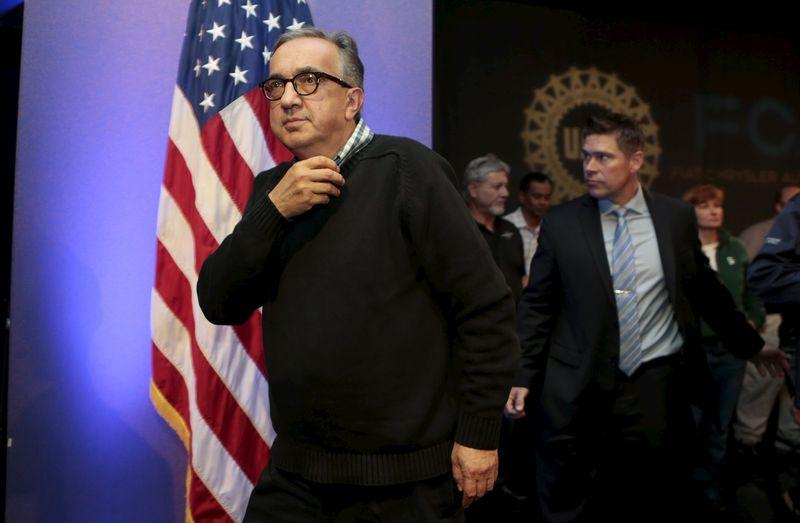 Fiat Chrysler Automobiles (FCA) CEO Sergio Marchionne leaves a news conference after announcing a tentative agreement with the United Auto Workers (UAW) in Detroit, Michigan