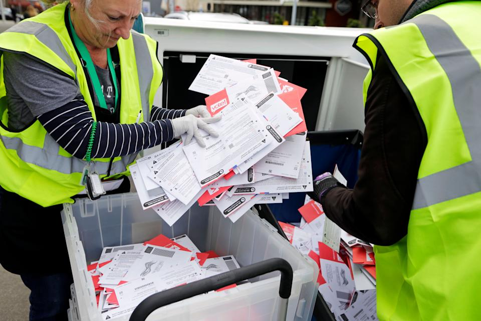 King County Election workers collect ballots from a dropbox in the Washington state primary on March 10, 2020, in Seattle. Washington is a vote-by-mail state. (Photo: AP Photo/John Froschauer)