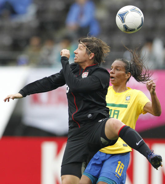 Amy LePeilbet of the United States, left, and Rosana Augusto of Brazil battle for the ball during their Kirin Challenge Cup women's friendly soccer match in Chiba, east of Tokyo, Tuesday, April 3, 2012. (AP Photo/Koji Sasahara)