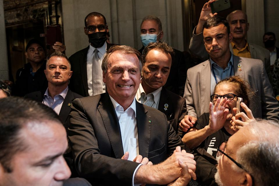 Brazil's President Jair Bolsonaro greets supporters outside his hotel during the 76th Session of the U.N. General Assembly in New York, U.S., September 21, 2021.  REUTERS/Stephen Yang