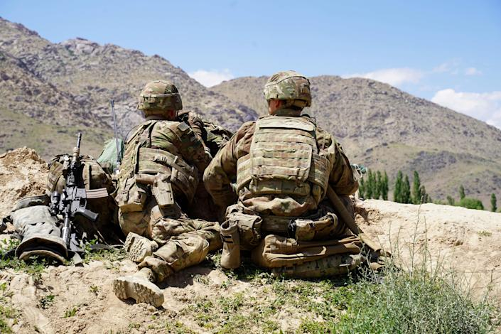 In this photo taken on June 6, 2019, US soldiers look out over hillsides in the Nerkh district of Wardak province in Afghanistan in June 2019.. (Thomas Watkins/AFP via Getty Images)