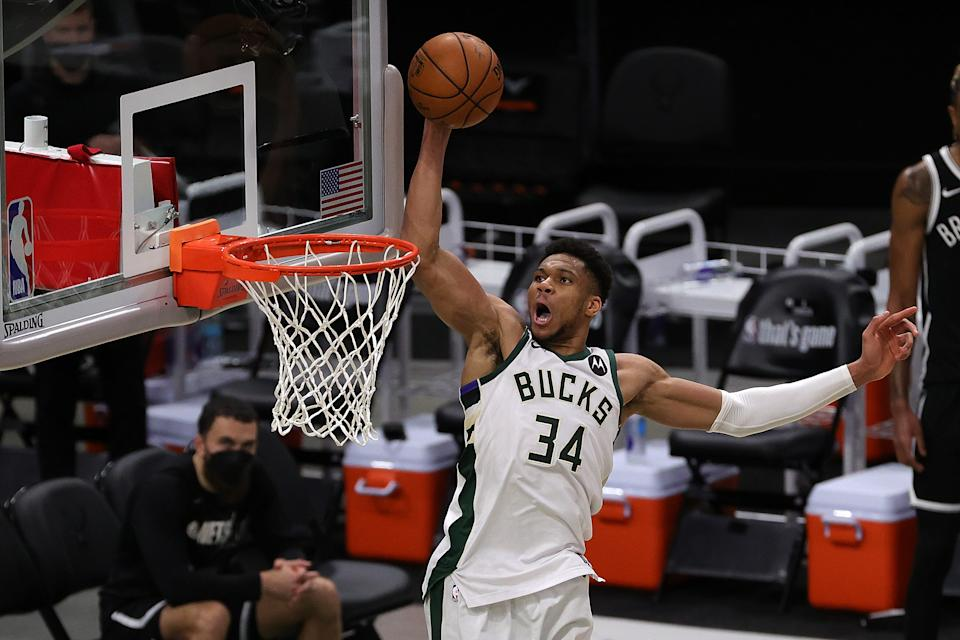 Giannis Antetokounmpo dunks against the Nets during the second half of Game 4 of the Eastern Conference semifinals on June 13, 2021. Milwaukee won to even the series at 2-2. (Stacy Revere/Getty Images)