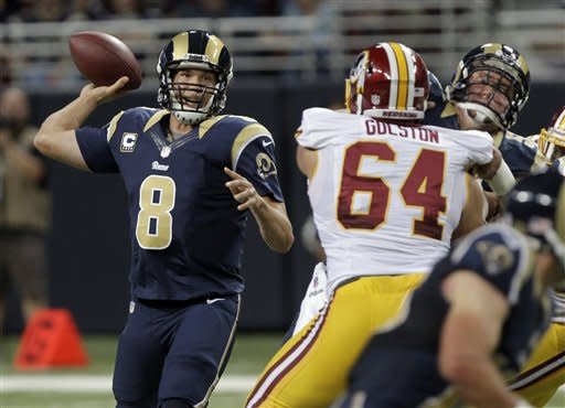 St. Louis Rams quarterback Sam Bradford, left, throws during the first quarter of an NFL football game against the Washington Redskins, Sunday, Sept. 16, 2012, in St. Louis. (AP Photo/Seth Perlman)