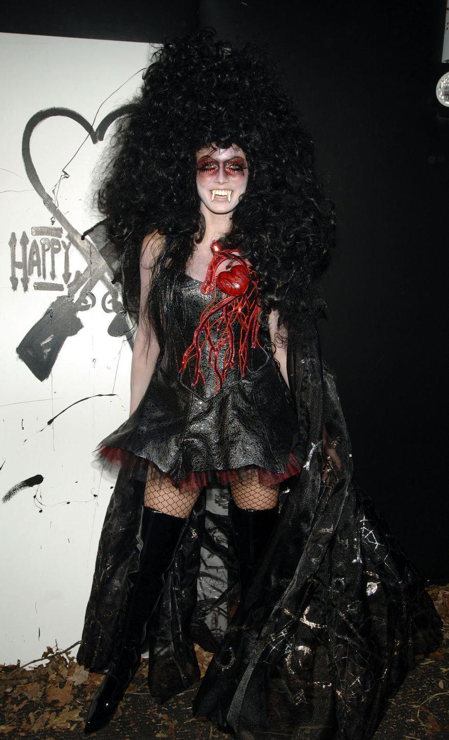<p>Turning to the dark side one year, Heidi wore a black corset dress pinned with a bleeding heart on her breast, teamed with a pair of thigh-high black patent leather boots.</p><p>Just look at that wig! </p>