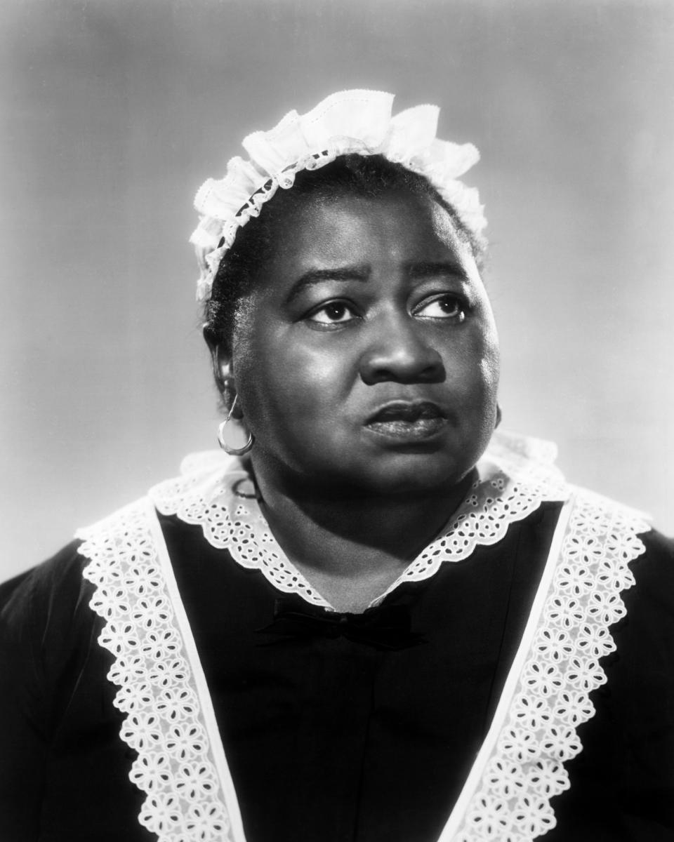 American actress Hattie McDaniel (1895 - 1952) in a maid's uniform, circa 1935. McDaniel won an Oscar for Best Supporting Actress for her role of Mammy in 'Gone With The Wind', making her the first African-American to win an Academy Award. (Photo by Silver Screen Collection/Getty Images)