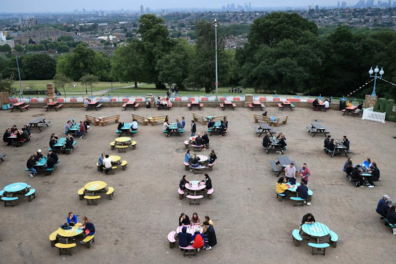 Socially distanced tables are served at The Terrace Bar, Alexandra Palace, London (PA)