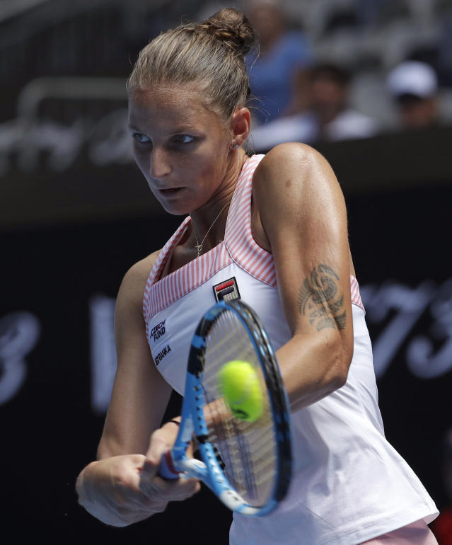 Karolina Pliskova of the Czech Republic makes a backhand return to compatriot Karolina Muchova during their first round match at the Australian Open tennis championships in Melbourne, Australia, Tuesday, Jan. 15, 2019. (AP Photo/Aaron Favila)