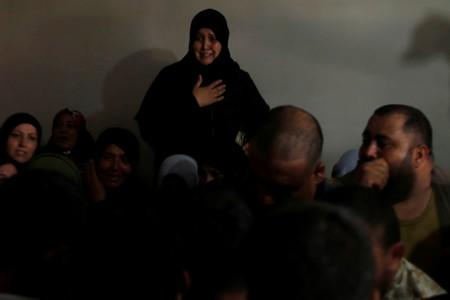 Relative of Palestinian Hamas fighter Mahmoud Al-Adham, 28, mourns during his funeral in the northern Gaza Strip