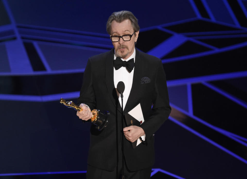 """Gary Oldman accepts the award for best performance by an actor in a leading role for """"Darkest Hour"""" at the Oscars on Sunday, March 4, 2018, at the Dolby Theatre in Los Angeles. (Photo by Chris Pizzello/Invision/AP)"""
