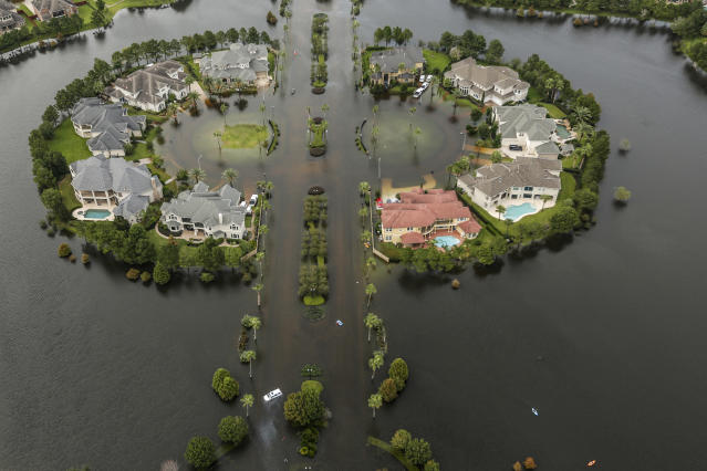 <p>Floodwaters fill the road running through the Lakes On Eldridge North subdivision in the aftermath of Tropical Storm Harvey on Wednesday, Aug. 30, 2017, in Houston, Texas. (Photo: Brett Coomer/Houston Chronicle via AP) </p>