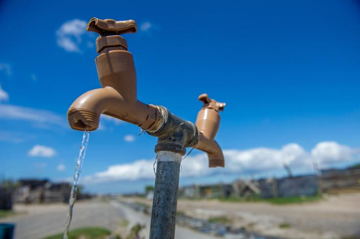 A communal tap runs for people in an informal settlement near Cape Town, South Africa, in January 2018. While the city urged residents to restrict water usage, many living in poor areas already had limited access to water. (Photo: ASSOCIATED PRESS)
