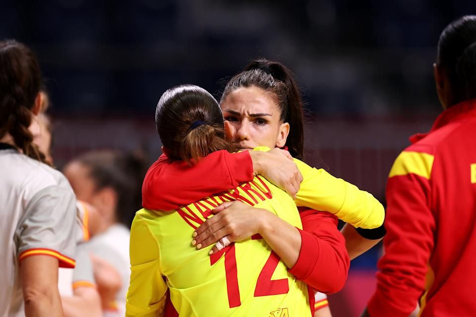 TOKYO, JAPAN - AUGUST 02: Carmen Dolores Martin Berenguer of Team Spain embraces teammate Silvia Navarro Gimenez after losing the Women's Preliminary Round Group B handball match between Spain and ROC on day ten of the Tokyo 2020 Olympic Games at Yoyogi National Stadium on August 02, 2021 in Tokyo, Japan. (Photo by Dean Mouhtaropoulos/Getty Images)