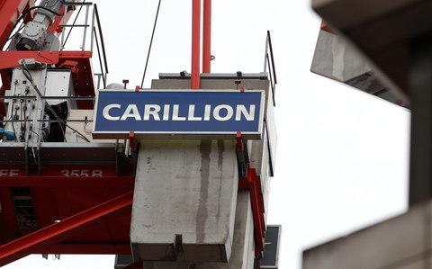 <span>Carillion logos are seen on building sites across the country</span> <span>Credit: PETER NICHOLLS </span>