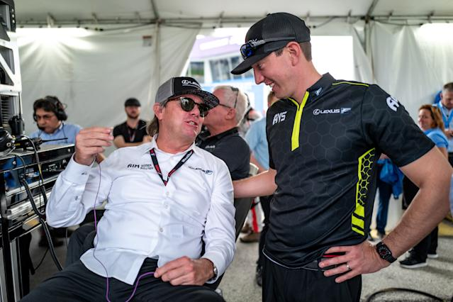 Kyle Busch talks with No. 14 co-owner Jimmy Vasser during the Roar (courtesy of IMSA).