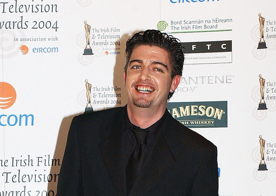 Karl Shiels pictured at the 2004 IFTAs in a black shirt and suit.