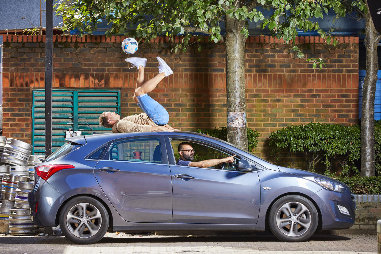 <p>The Guinness Book of World Records 2019 hits the shelves today, revealing world records like Ash Randall's record for the longest time controlling a football with the soles whilst on the roof of a moving car [Photo: Paul Michael Hughes/Guinness World Records] </p>