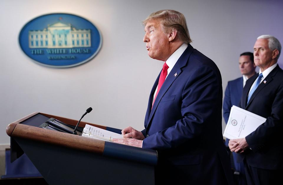 Donald Trump speaks at a White House briefing on the coronavirus pandemic: AFP via Getty Images