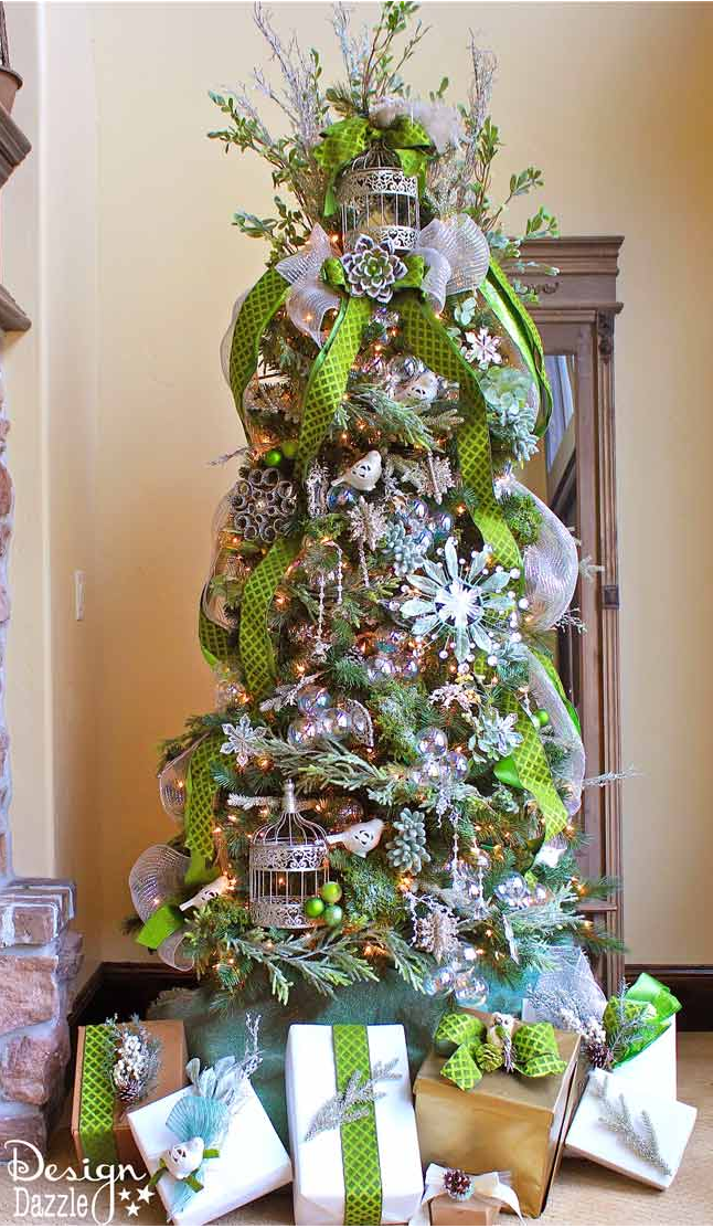 "<p>Instead of wrapping your tree in a horizontal direction, drape ribbon vertically for a fresh look.</p><p>See more at <a href=""http://www.designdazzle.com/2013/11/michaels-dream-tree-challenge-2013/?crlt.pid=camp.fgzkAxWpX0o0"" rel=""nofollow noopener"" target=""_blank"" data-ylk=""slk:Design Dazzle"" class=""link rapid-noclick-resp"">Design Dazzle</a>.</p><p><a class=""link rapid-noclick-resp"" href=""https://www.amazon.com/inch-feet-Deco-Poly-Ribbon/dp/B0058PSU5Y/?tag=syn-yahoo-20&ascsubtag=%5Bartid%7C10057.g.505%5Bsrc%7Cyahoo-us"" rel=""nofollow noopener"" target=""_blank"" data-ylk=""slk:SHOP GARLAND"">SHOP GARLAND</a> <em><strong>Green Ribbon Garland, $10</strong></em><br></p>"