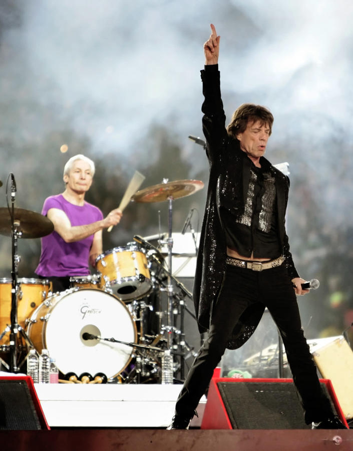FILE - Mick Jagger, right, and drummer Charlie Watts, perform with the Rolling Stones at halftime of the Super Bowl XL football game in Detroit on Feb. 5, 2006. Watts' publicist, Bernard Doherty, said Watts passed away peacefully in a London hospital surrounded by his family on Tuesday, Aug. 24, 2021. He was 80. (AP Photo/David J. Phillip, File)